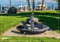 Old anchor in grasslands in a harbor on the Lake Constance or Bodensee