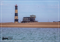 Famous lighthouse at the Atlantic Ocean near Walvis Bay in Namibia